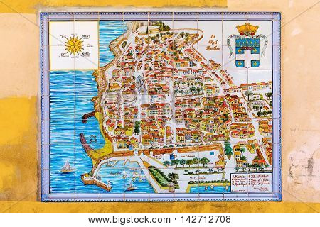 Antibes France - July 24 2016: city map of Antibes on wall tiles. Antibes is a Mediterranean resort in the Alpes-Maritimes department of southeastern France on the Cote d Azur