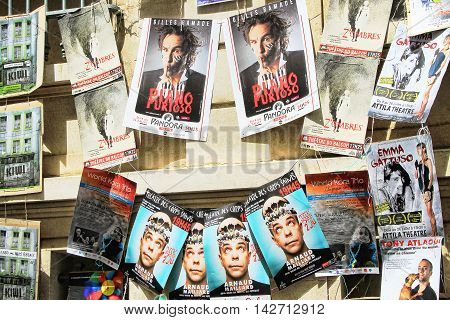 AVIGNON, FRANCE - JULY 05 2015: plenty of playbills on a wall during famous theatre festival from July 03 to 27 2014 in Avignon south of France.