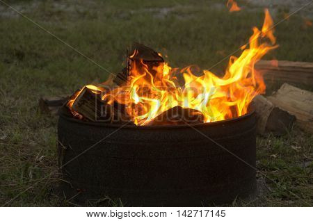 A campfire burns and creates a calming atmosphers at a campground in Emerald Isle North Carolina