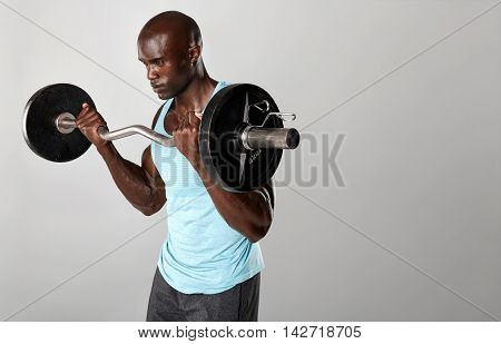 Young Muscular Man Exercising With Weights