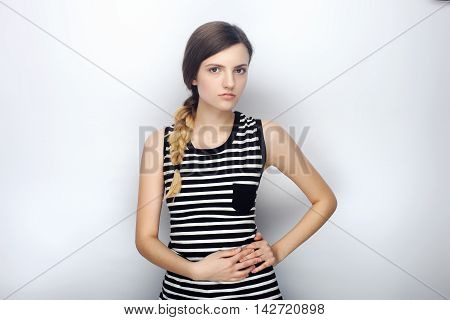 Portrait Of Serious Young Beautiful Woman In Striped Shirt Incredulous Looking Into Camera Posing Fo