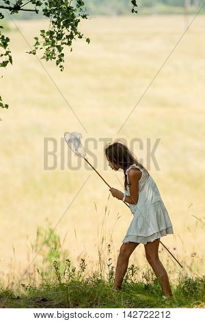 Girl With Butterfly Net And A White Dress