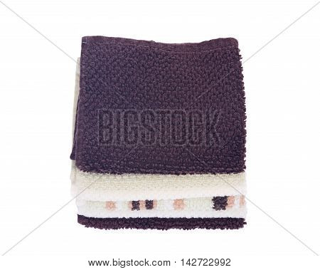 Organic cotton folded bath towels separated on white background