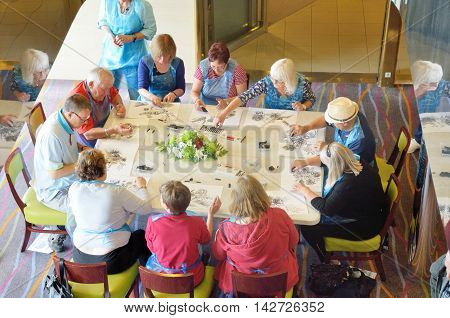 North Sea England United Kingdom - July 28 2016: Art class taking place on cruise with small group of passengers