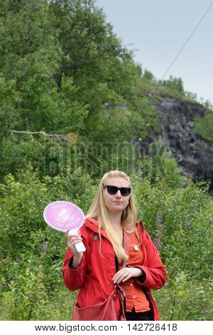 Flam Norway - July 30 2016: Attractive tour guide for cruise ship tour with board