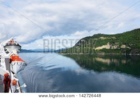 Geirangerfjord Norway - July 31 2016: View of Geirangerfjord Norway from rear of cruise ship Magellan