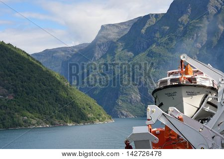 Geirangerfjord Norway - July 31 2016: View of Geirangerfjord Norway from rear of cruise ship Magellan with mountains to rear