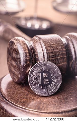 Bitcoin and gavel. Cryptocurrency out of law concept.Toned