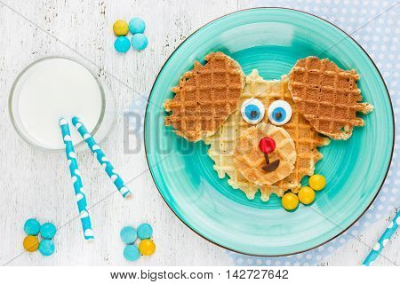 Puppy dog waffles for baby breakfast. Animal-shaped adorable art food for kids. Creative idea for child fun dessert or breakfast