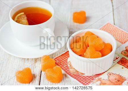 Sugar shaped hearts colored with carrot juice. Creative cooking idea and love concept