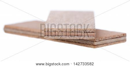 Close Up Heap Of Wooden Dowel Pins Isolated On White