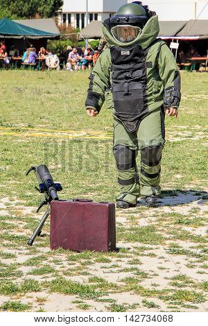 LAUDUN, FRANCE - MAY 01 2014: Bomb Squad specialiste and vehicle equipped with a remote-controlled robot detection and detonation equipment during French Foreign legion open Day on May 01 2014