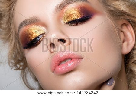 Close up beauty portrait of young woman with beautiful summer bright makeup. Modern smokey eyes with colorful metallic eyeshadows. Studio shot poster