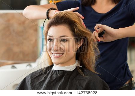 Female hairdresser and client deciding what haircut to do. Healthy hair latest hair fashion trends changing haircut style concept