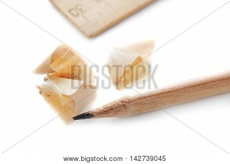 pencil with shavings and straightedge isolated on white background