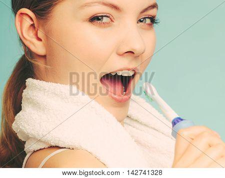Girl Singing Using Toothbrush.