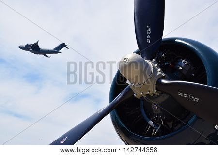 Propeller of a Corsair plane with a Skymaster jet flying by.