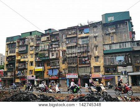 Hanoi, Vietnam - Aug 15, 2016: Close up of an old and ruin apartment residential building on a street of Hanoi capital. There are some building built since Soviet period still in use now.