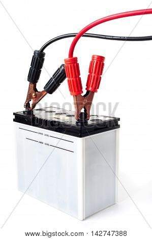 closeup car battery with jumper cable over white