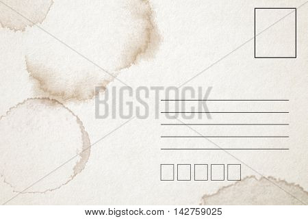Backside of blank postcard with coffee stain