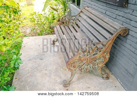 Wood Bench against brick wall