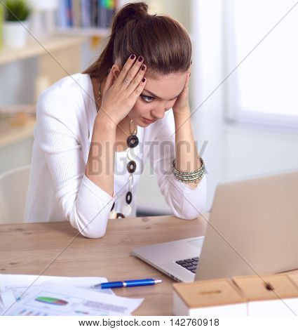 Stressed businesswoman sitting at desk