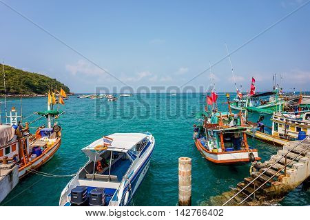 Koh Larn, Thailand - July 02, 2016: Colorful Fishing Boats and speed boat in Koh Larn Harbor
