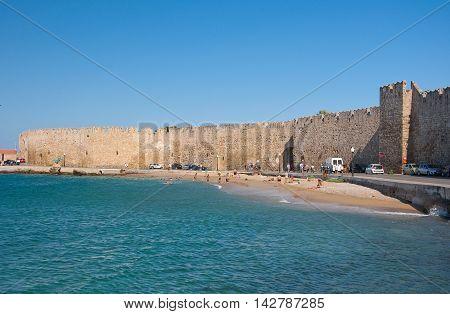 Mandraki harbor and a beach on July 1 2013. Rhodes Greece.