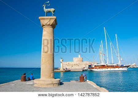 Mandraki harbor and bronze deer on Rhodes island Greece.