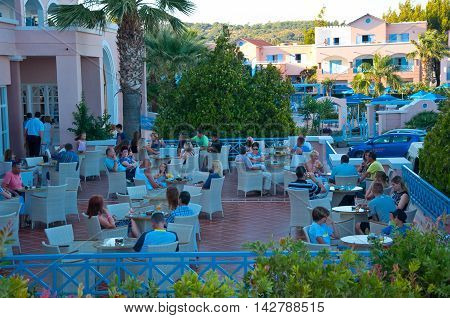 RHODES ISLAND GREECE- JULY 1: Holidaymakers have their drinks in a restaurant of Mitsis Rhodos Village 5* hotel on July 1 2013. Rhodes Island Greece.