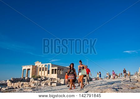 The Erechtheion and tourists on Acropolis of Athens. Greece.