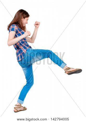 back view of woman funny fights waving his arms and legs. Rear view people collection. backside view of person.  Isolated over white background. Girl in plaid shirt has a foot.