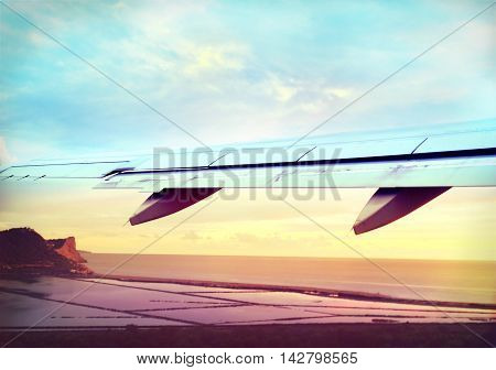 Airplane taking-off in the sunset or sunrise with blurred motion.