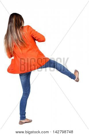 back view of woman funny fights waving his arms and legs. Rear view people collection. backside view of person.  Isolated over white background. student in a red jacket kicks.