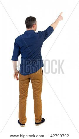 Back view of pointing business man.  Rear view people collection.  backside view of person.  Isolated over white background. a man in a blue shirt with the sleeves rolled up showing up with his right