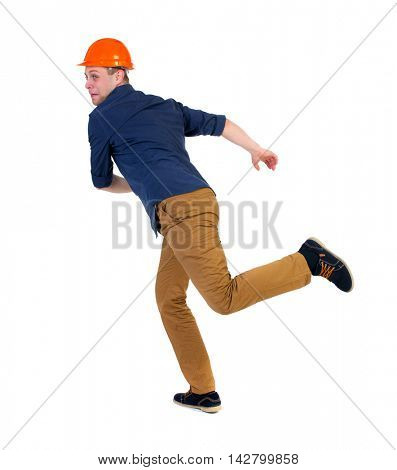 Back view of running engineer in helmet. Walking guy in motion. Rear view people collection. Backside view of person. Isolated over white background. a man in a blue shirt and a helmet in horror runs