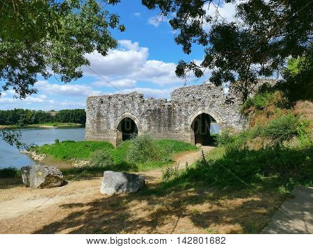 Arched toll bridge le Cul du Moulin at the Loire on a sunny day