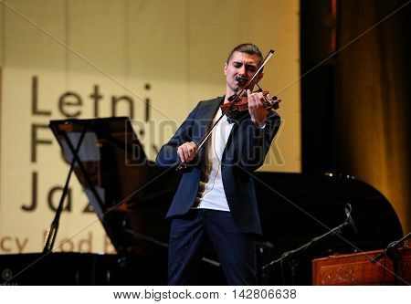 CRACOW POLAND - JUNE 11 2016: Adam Baldych - Polish violinist playing live music at Summer Jazz Festival in Cracow Poland