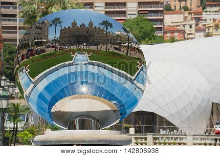 MONTE CARLO, MONACO - JUNE 17, 2015: Reflection of the Monte Carlo Casino in the Sky Mirror sculpture by Anish Kapoor in Monte Carlo, Monaco.