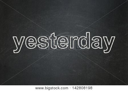 Time concept: text Yesterday on Black chalkboard background