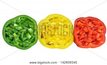 Slices of red bell pepper, green and yellow colors, filled with chopped flesh, lie horizontally in row. Isolated on white background