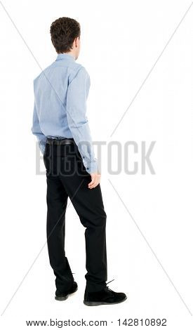 back view of Business man  looks.  Rear view people collection.  backside view of person.  Isolated over white background. The curly-haired businessman in light shirt stands sideways and looks forward
