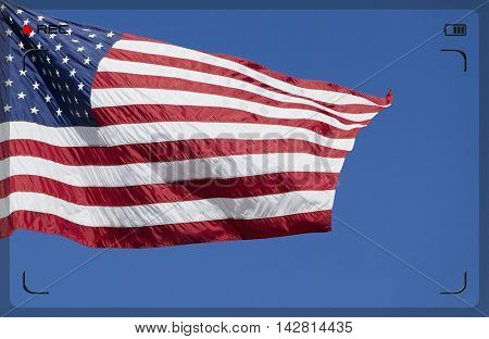 Recording US Stars and Stripes Flag on blue background