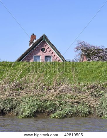 Building or house behind a dyke. Home protection of high tide water level.
