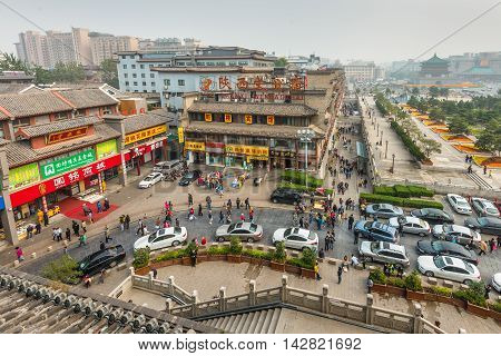 Xian China - October 17 2013: Street scene near the Bell Tower in Xian obscured in the smog Shaanxi Province China.