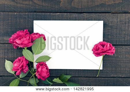 Frame Of Roses On Dark Rustic Wooden Background With Empty Card For Greeting Message. Valentine's Da