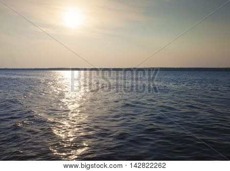 Sun at a low angle over a lake in Saskatchewan Canada