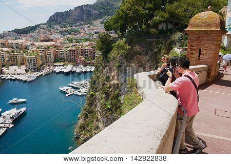 MONACO, MONACO - JUNE 17, 2015: Unidentified people take photos of the Fontvieille and Monaco Harbor in Monaco.