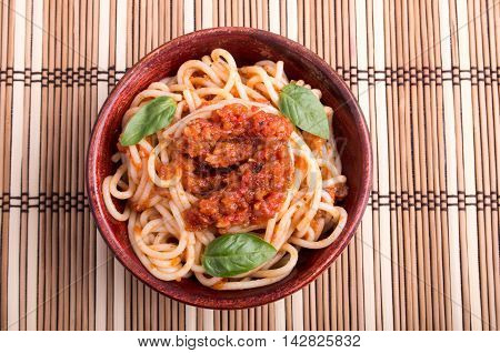 Top View Of A Thin Spaghetti In A Brown Small Wooden Bowl