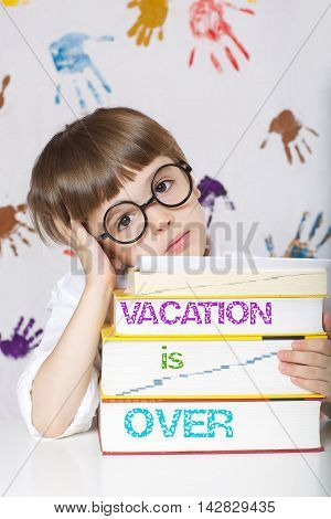 Boy Of Seven Years Old With Books.vacation Is Over
